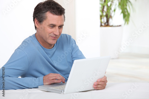 Man in front of a laptop computer