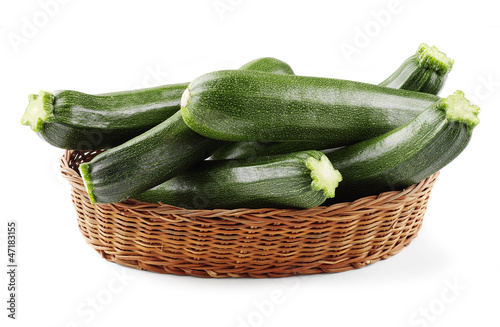 zucchini in basket isolated