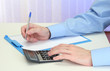 Closeup of businessman hands with calculator