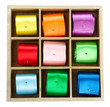 bright silk ribbons  in wooden box, isolated on white