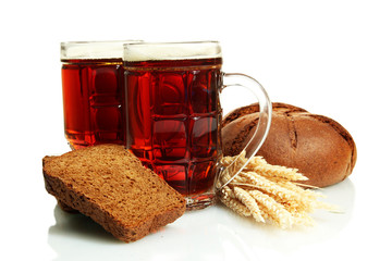 tankards of kvass and rye breads with ears, isolated on white