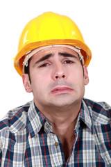 workman making grimace