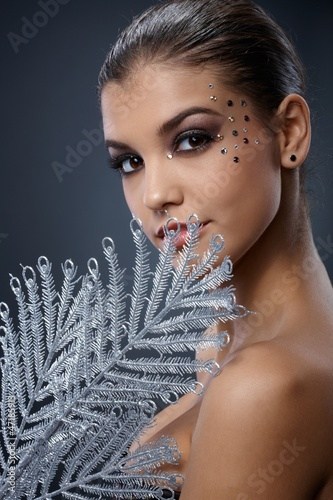 Seductive woman with silver fan