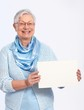 Smiling old lady with blank sheet