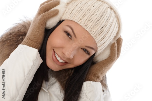 Beautiful smiling woman at winter