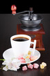White cup of Turkish coffee with rahat delight and coffee mill