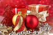 Christmas decoration and gifts on red background