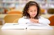 School girl reading a book