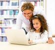 ICT teacher with a student