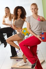 Young women exercising with ball