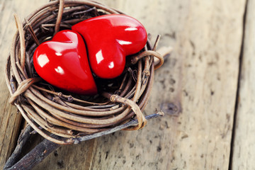 Two red hearts in bird's nest