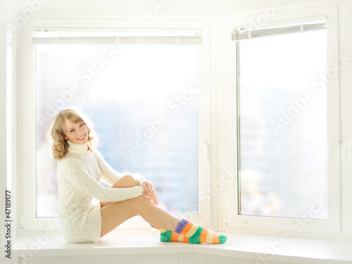 Beautiful girl sitting at the window