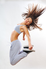 fitness instructor jumping in studio
