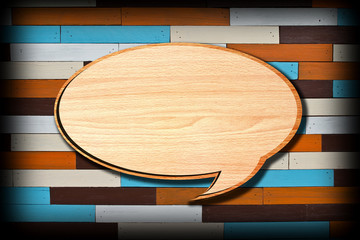 Retro speech bubbles from splat on wood wall background