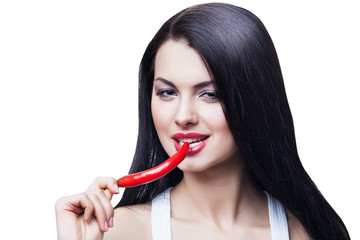 sexy brunette woman biting chili pepper