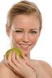 Young Beautiful Woman holding a green apple
