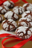 Chokolate crinkles cookies on a golden table poster