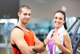 Fitness woman with a personal trainer