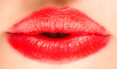 Sweet kiss. Sexy red lip makeup close-up