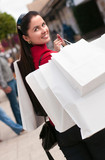 Happy smiling woman shopping with white bags