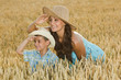 mother and son in a field of wheat