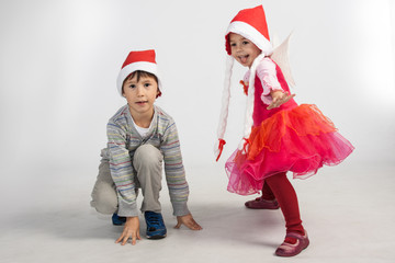 Boy and girl in Santa hats
