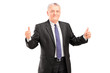 Happy mature businessperson standing and giving thumbs up