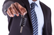 Young African American businessman holding a car key.