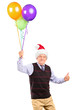 Gentleman with hat holding balloons and giving thumb up