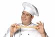 Un cocinero,chef probando pan.palillo de pan.