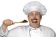 Cocinero chef probando crema de chocolate.
