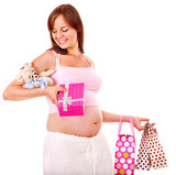 Pregnant woman with shopping bag.