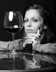 Beautiful girl with glass of wine B&W image