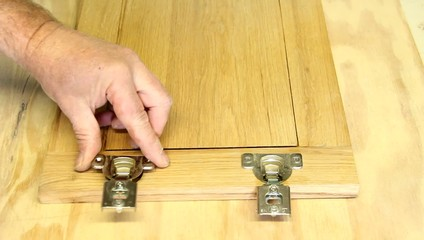attaching hinges to door