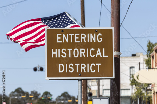 Entering Historical District Road Sign with American Flag