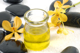 Spa products: yellow orchid and, stones