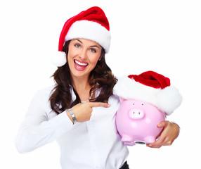 Santa Christmas business woman with a piggy bank.
