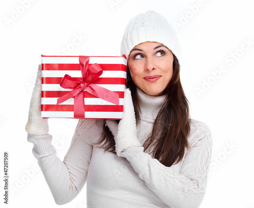 Beautiful christmas girl with a gift.