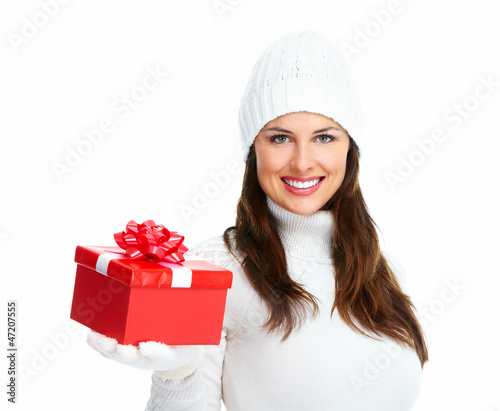 Beautiful young Christmas girl with gift.