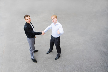business partners concluded a bargain on the street