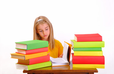 Education - beautiful girl reading a book surrounded by books