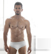Sexy young male muscular model in white underwear