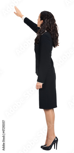 Full body of business woman pointing, isolated