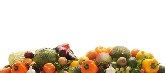 A pile of fresh and tasty fruits and vegetables on white