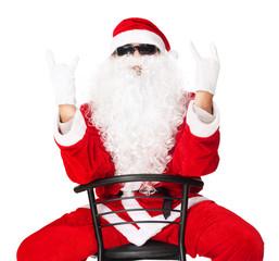 Santa Claus showing rocker hand sign