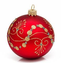 Red christmas ball on a white