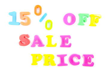 15% off written in fridge magnets on white background