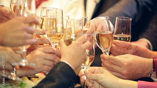 Guests raising glasses for a toast on a wedding
