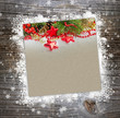 Christmas postal on a wooden background with snowflakes