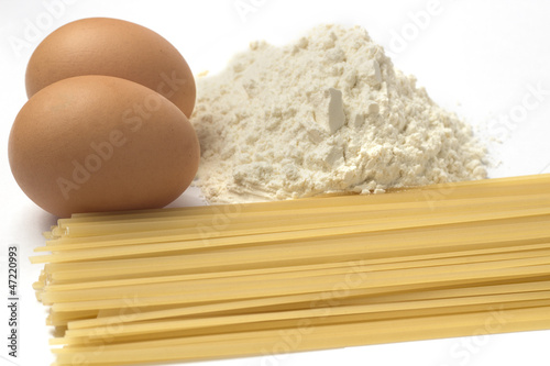 Eggs flour and pasta on a white background